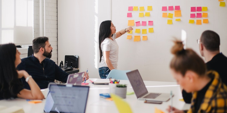 woman showing postits on wall