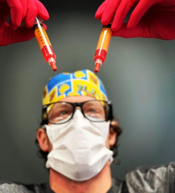 Dr. Chestnut looking at vials
