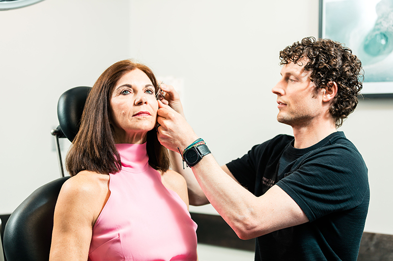 Dr. Chestnut injecting botox into client