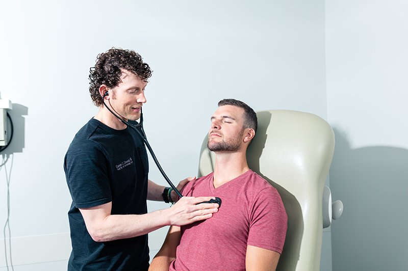 Dr. Chestnut checking client's heartbeat