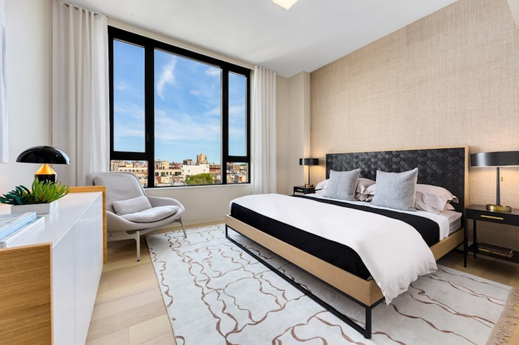 bedroom indoors room rug bed furniture