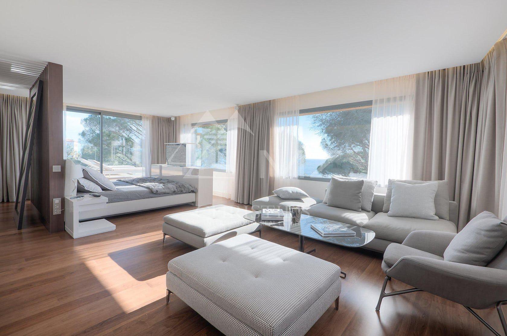 furniture living room room indoors interior design couch flooring wood table hardwood