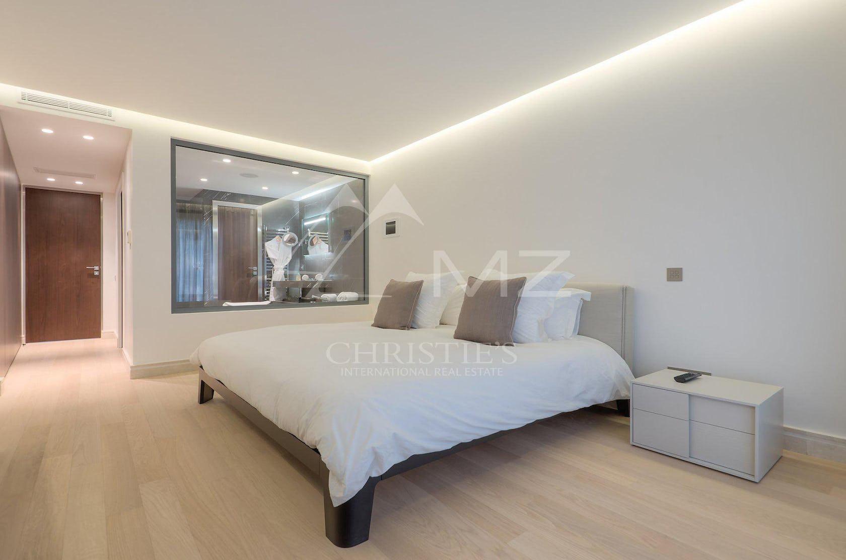 furniture bed flooring bedroom indoors room floor interior design wood