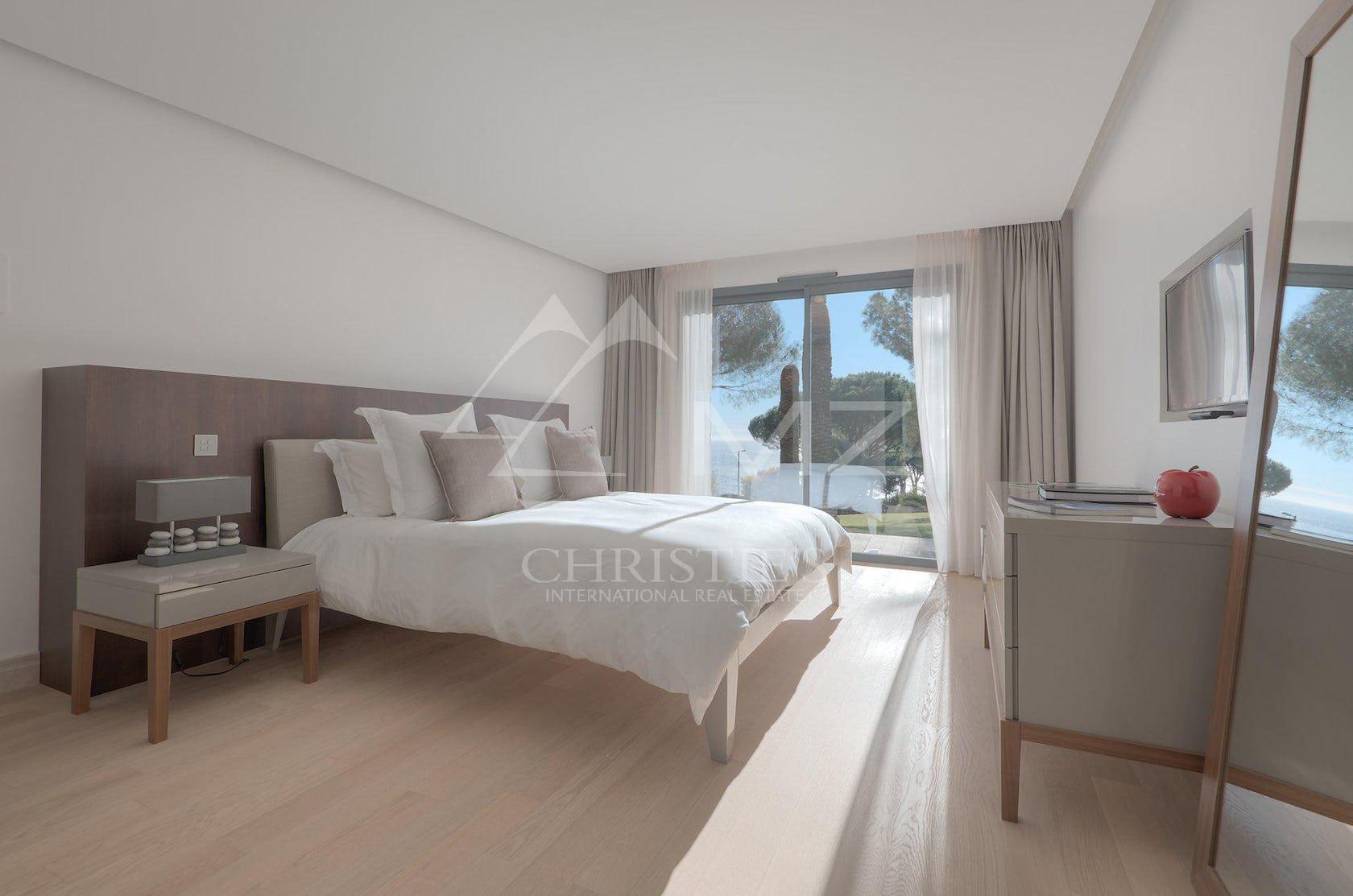 flooring wood floor bedroom indoors room furniture hardwood interior design bed