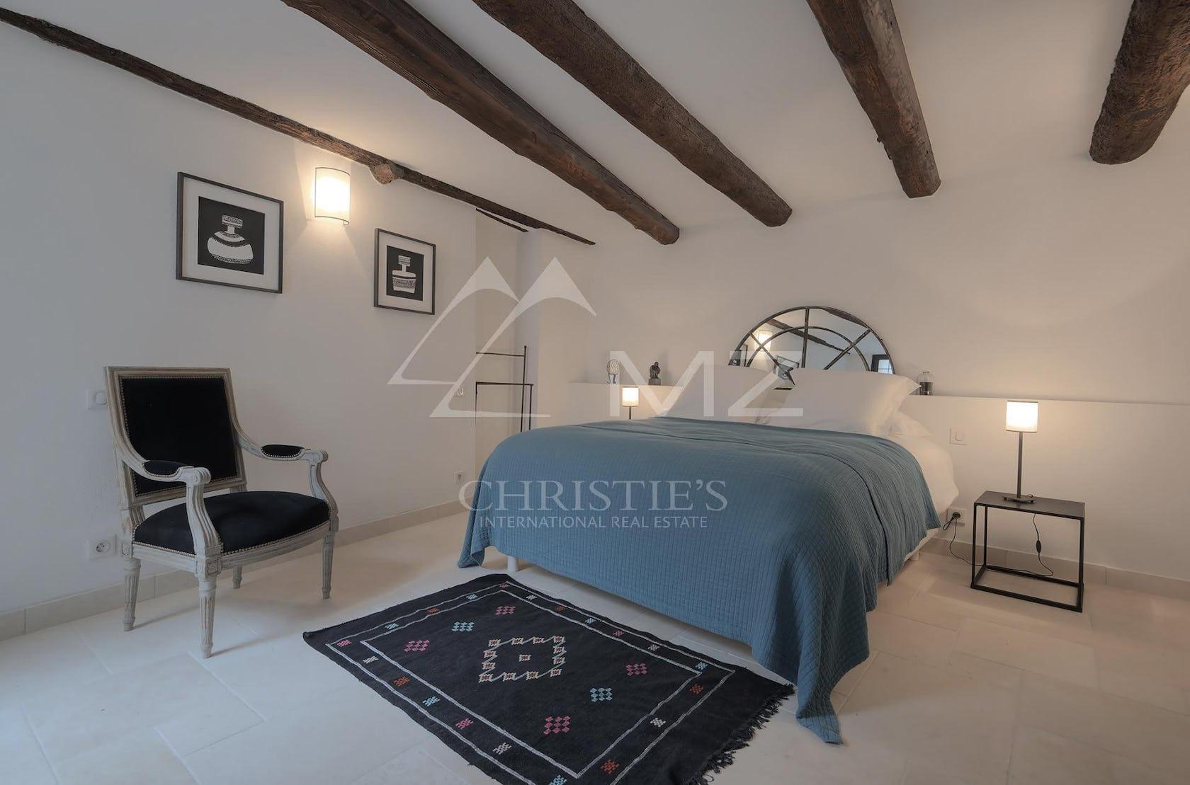 loft housing building indoors attic chair furniture rug bed bedroom