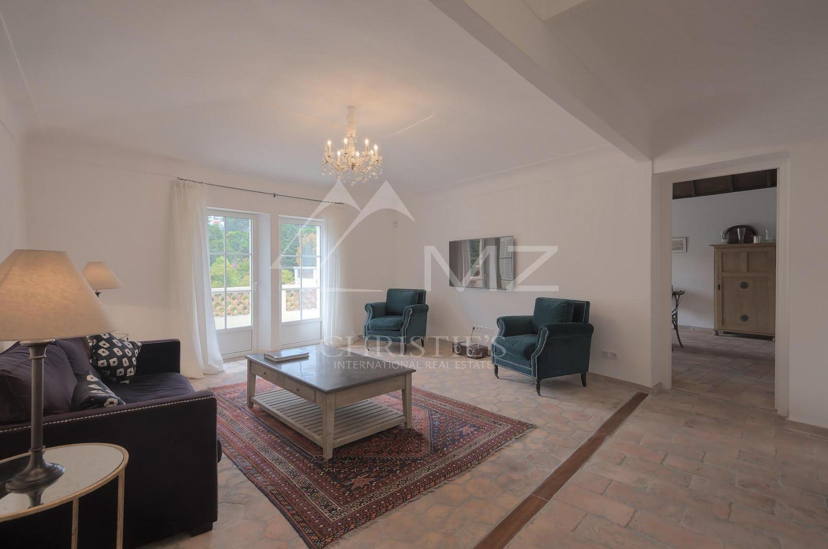 furniture flooring table living room room indoors coffee table floor interior design rug