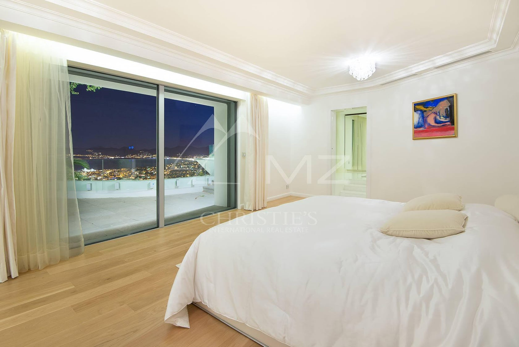 bedroom indoors room flooring bed furniture floor wood screen hardwood