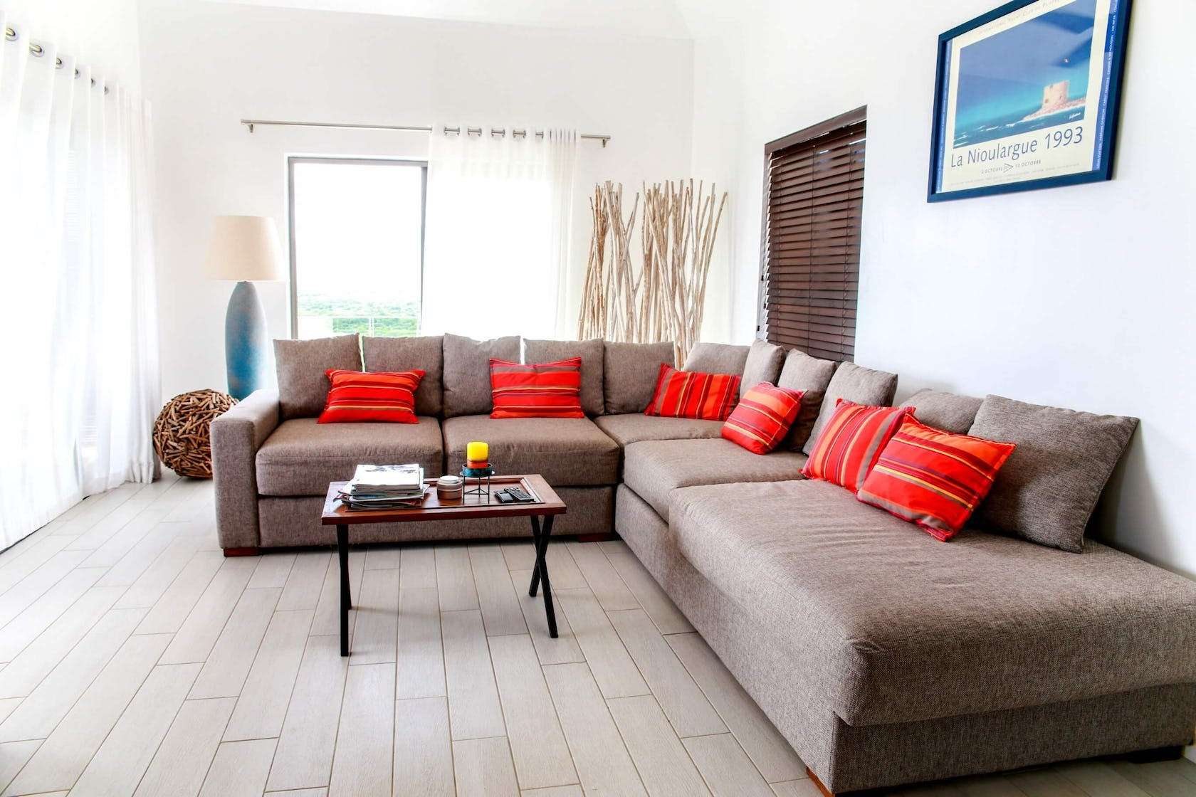 couch furniture living room room indoors interior design flooring table cushion coffee table