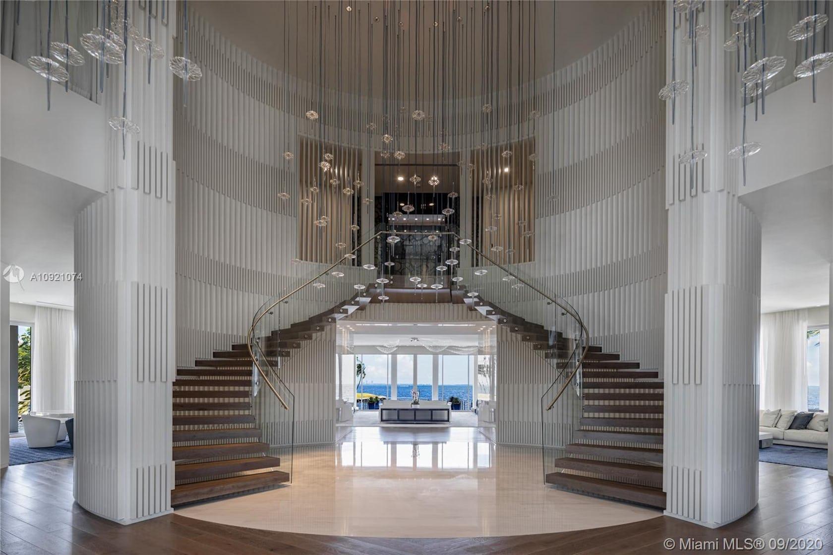 handrail banister flooring floor lobby room indoors interior design staircase lighting