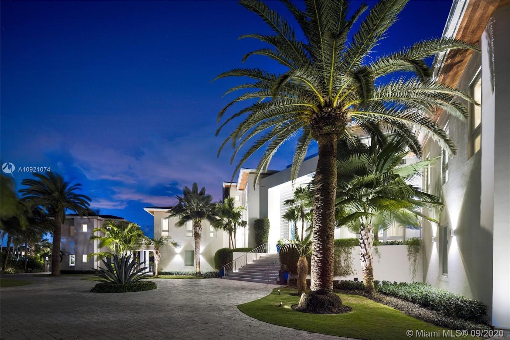 villa housing building house summer palm tree plant arecaceae tree outdoors