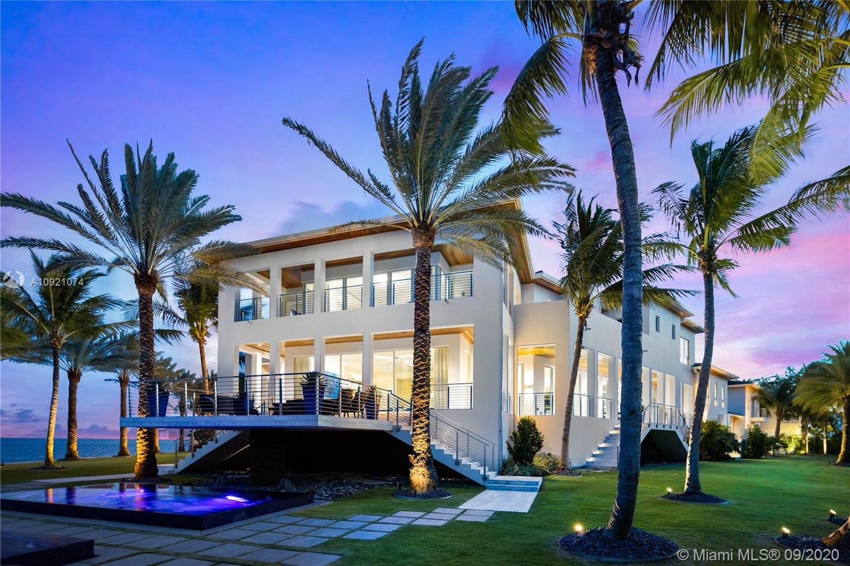 villa housing building house plant palm tree tree grass hotel mansion