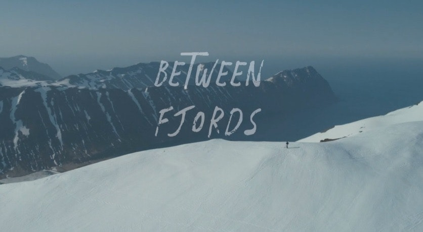 Cover Image for BETWEEN FJORDS. nature,outdoors,peak,mountain range,mountain,slope,sport,snow,snowboarding,piste