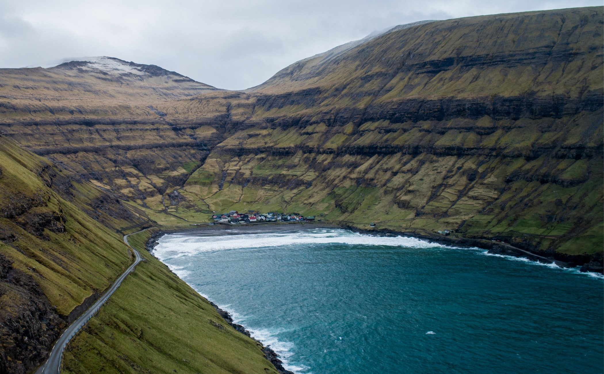nature,outdoors,promontory,mountain,water,ocean,sea,slope,shoreline