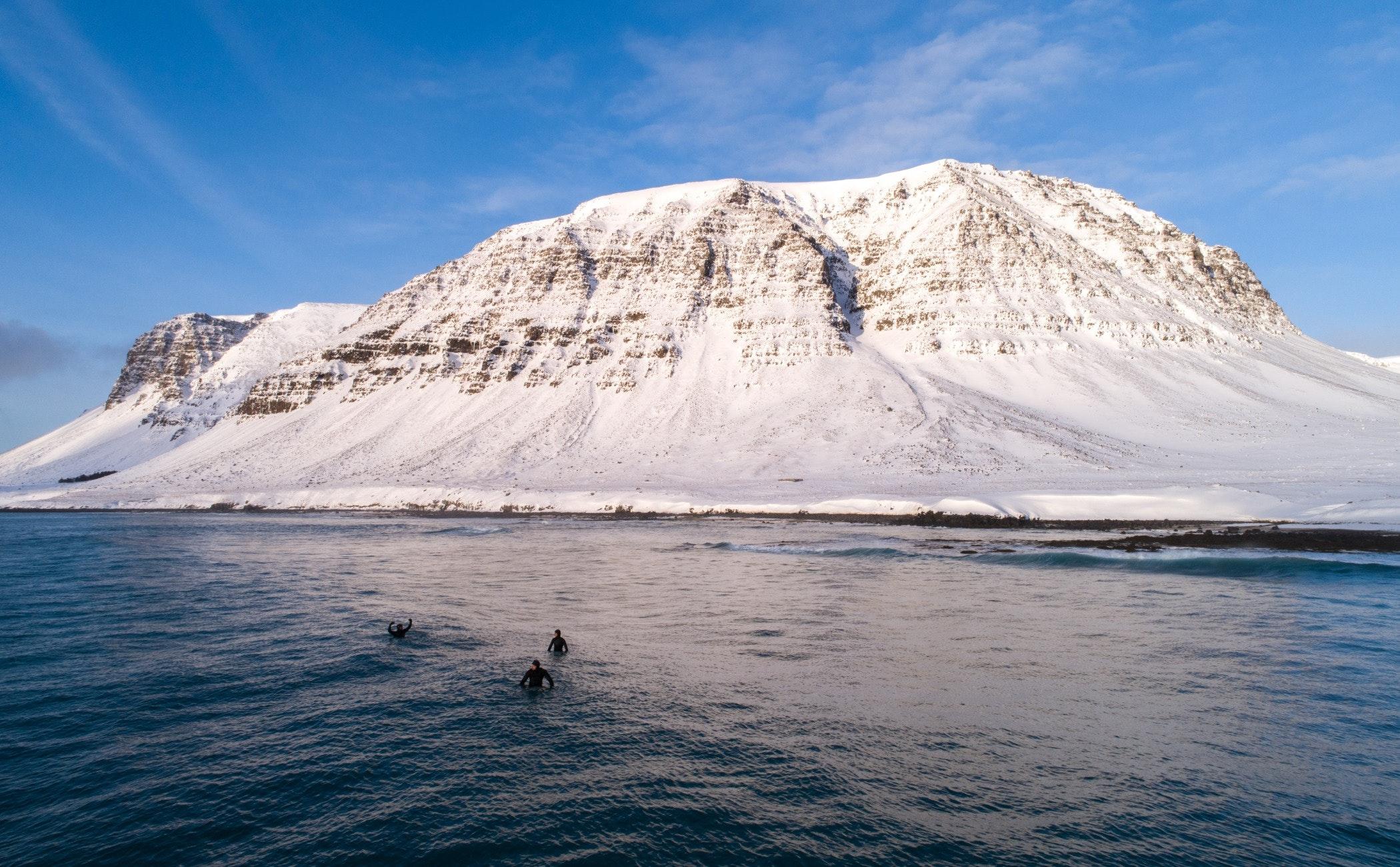nature,mountain,outdoors,human,person,ice,mountain range,peak,snow