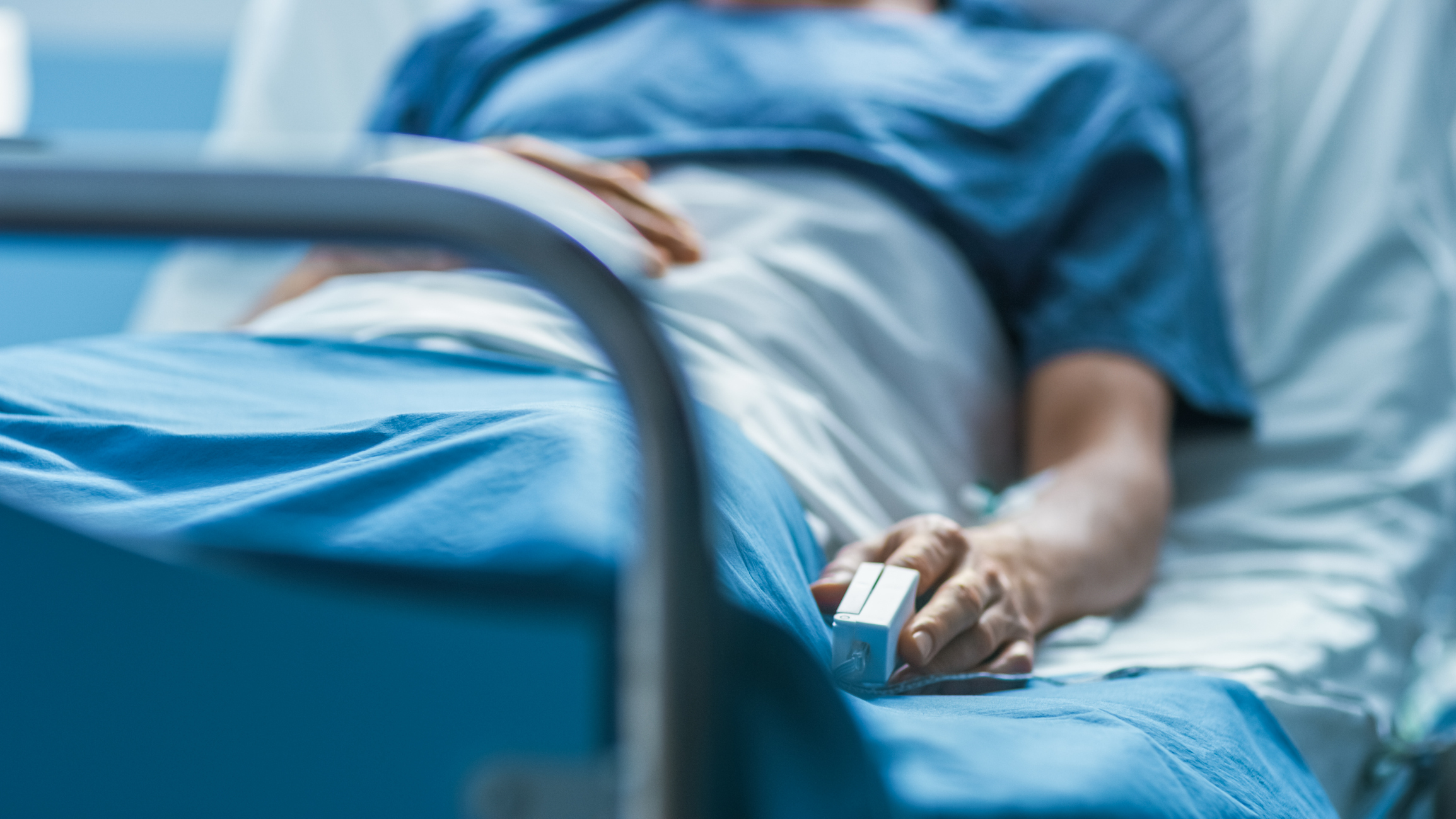 Person laying in hospital bed