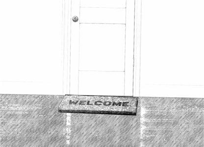 Wycieraczka z napisem welcome pod drzwiami