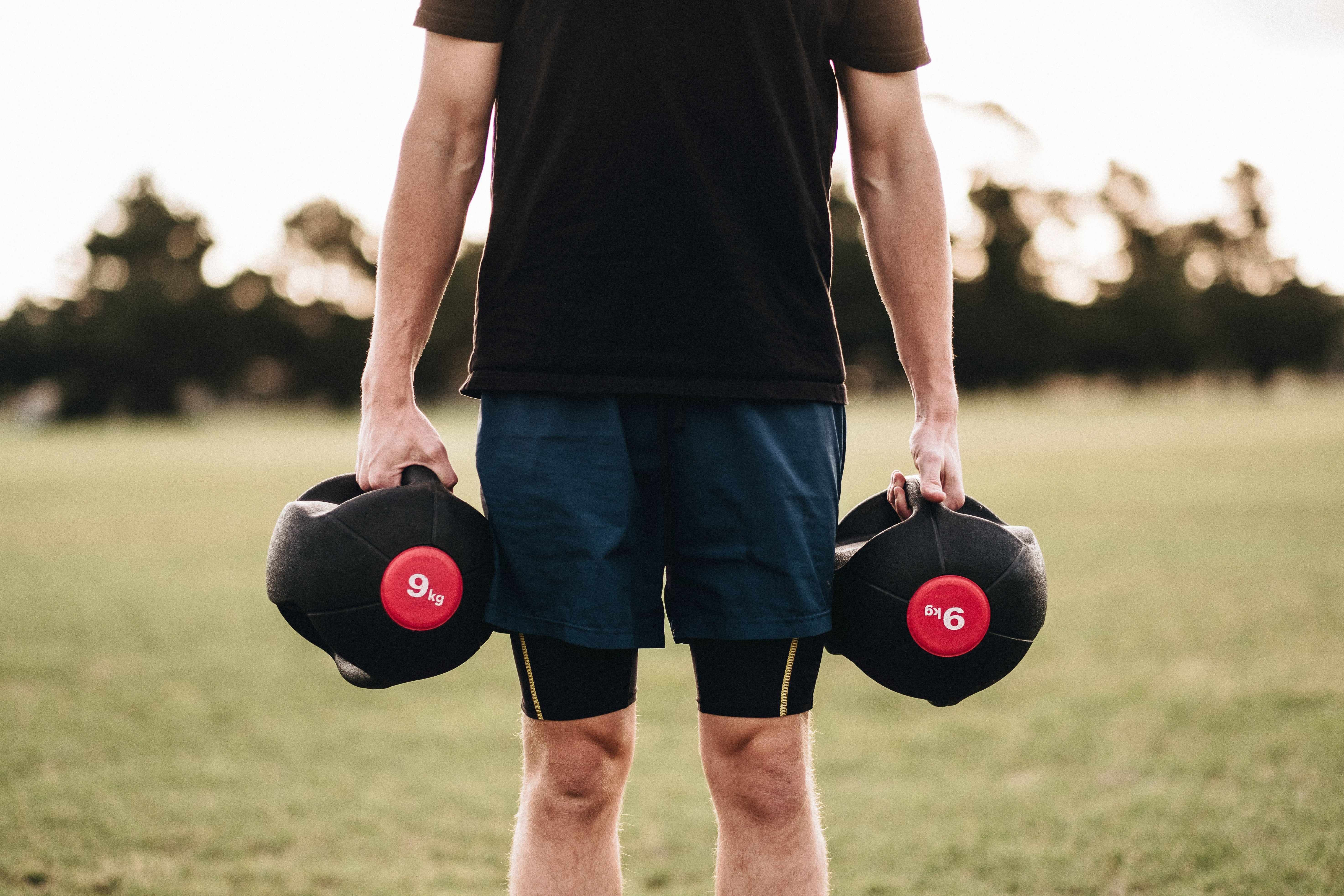 Image of a man with dumbbells doing lateral hand raises