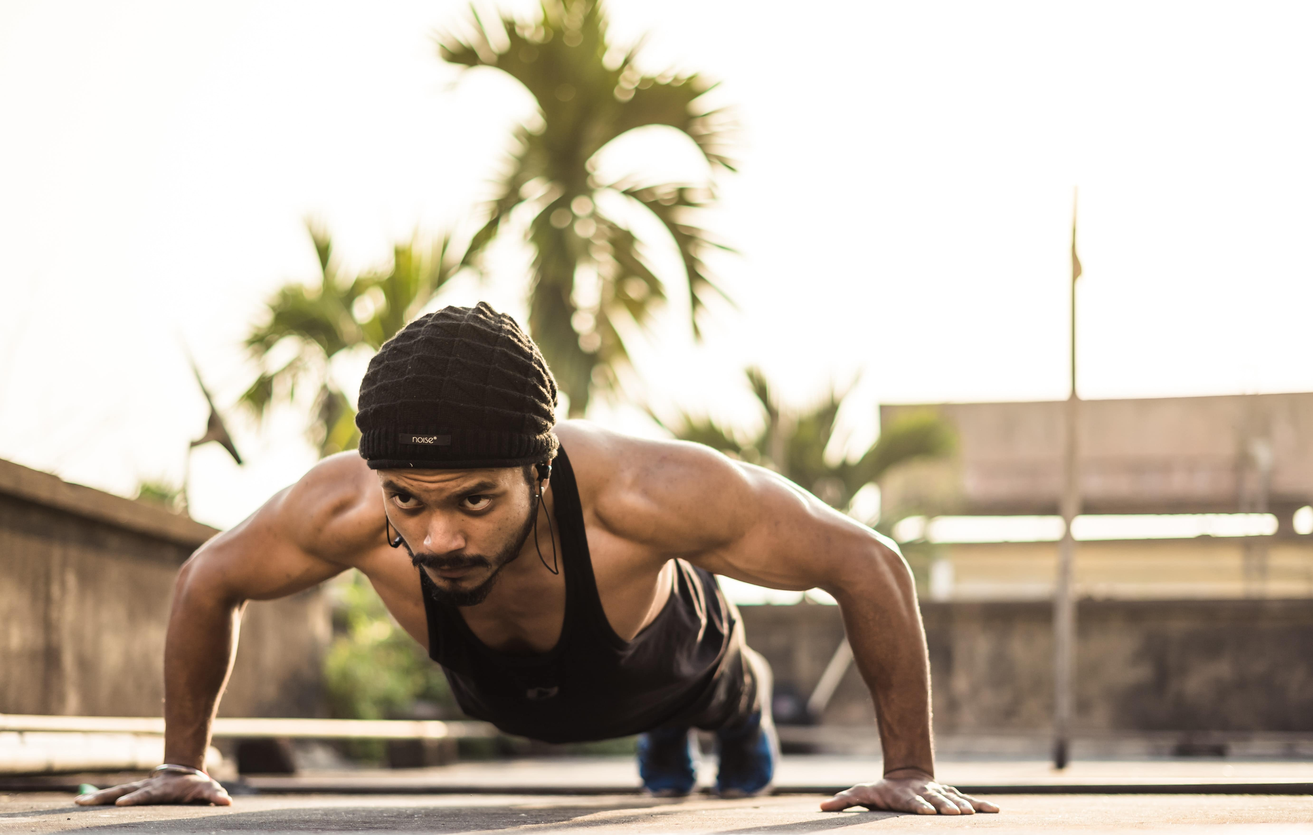 Image of a man doing push ups in a outdoor space