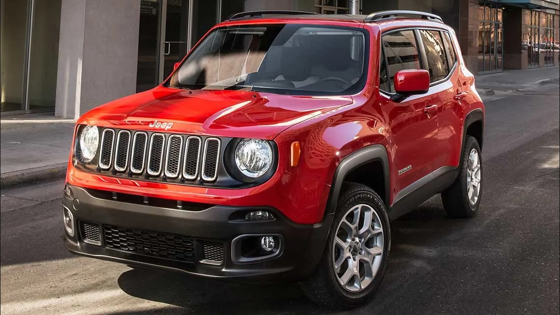 A sturdy looking scarlet red jeep