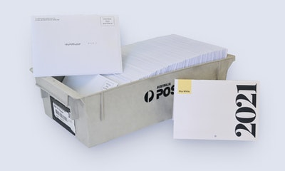 Photograph of an Australia Post mail tray full of direct mail envelopes