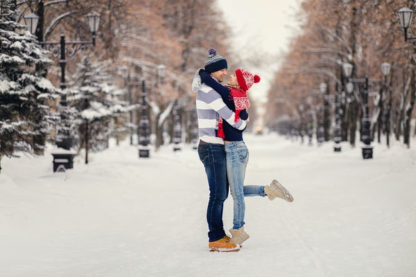 Couple Hugging in Snowy Forest