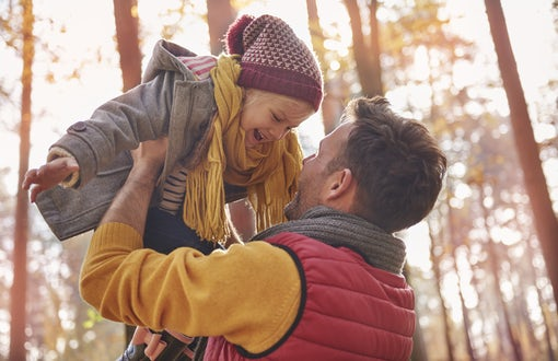 Dad and child in Autumn forest