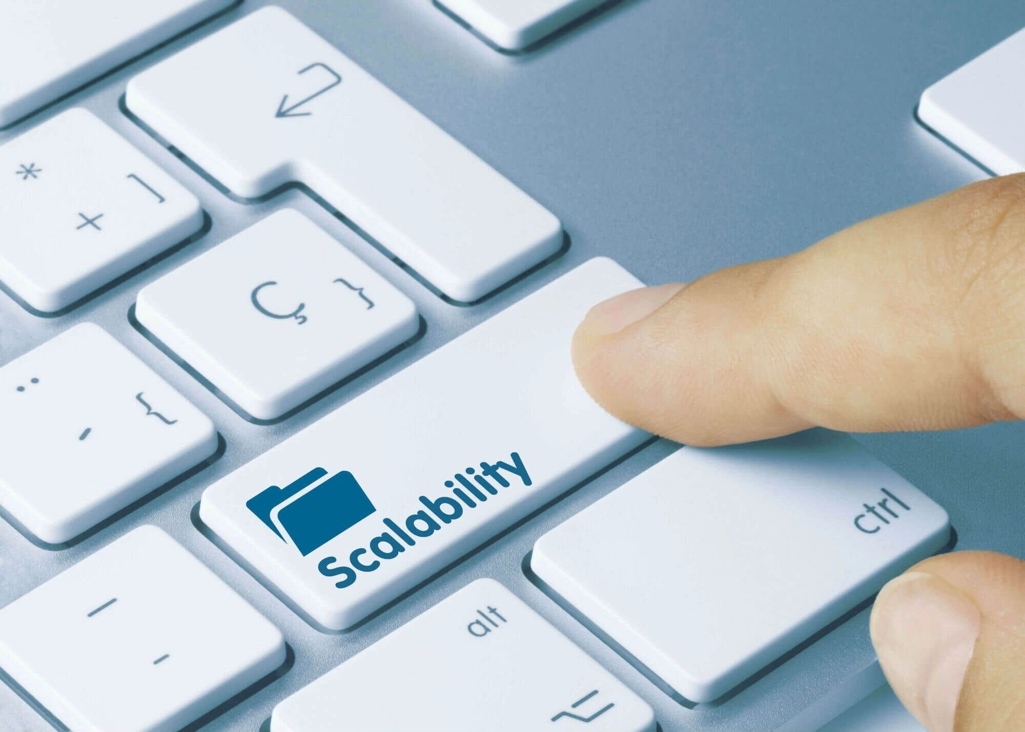finger pressing key that says scalability