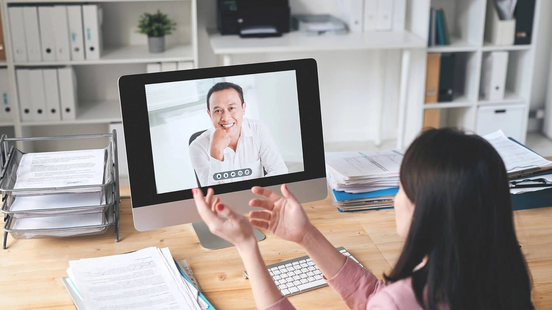 woman and man chatting by video call