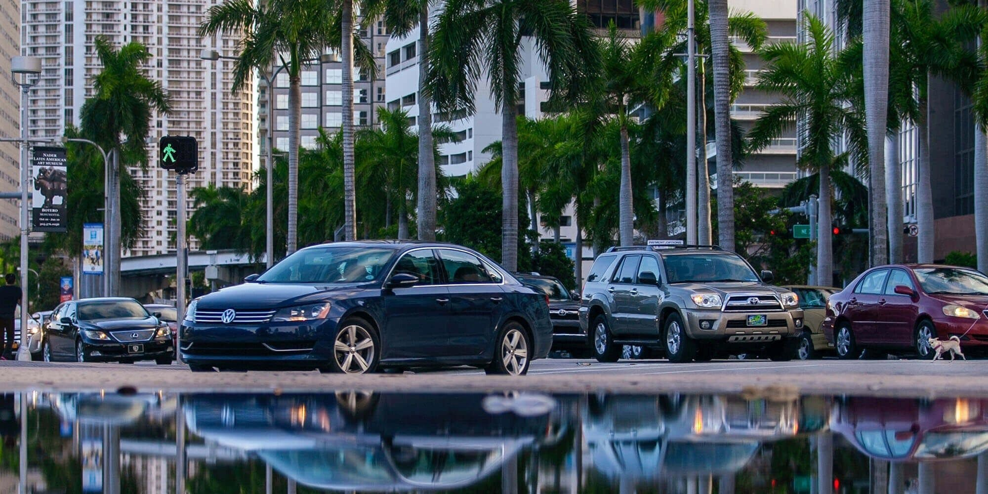 cars and their reflection in the water
