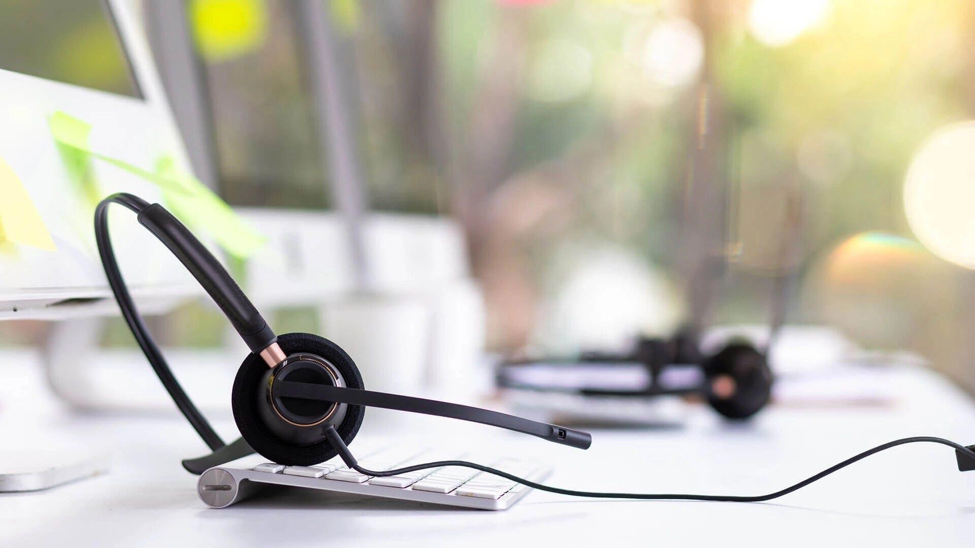 headphones over computer keyboard