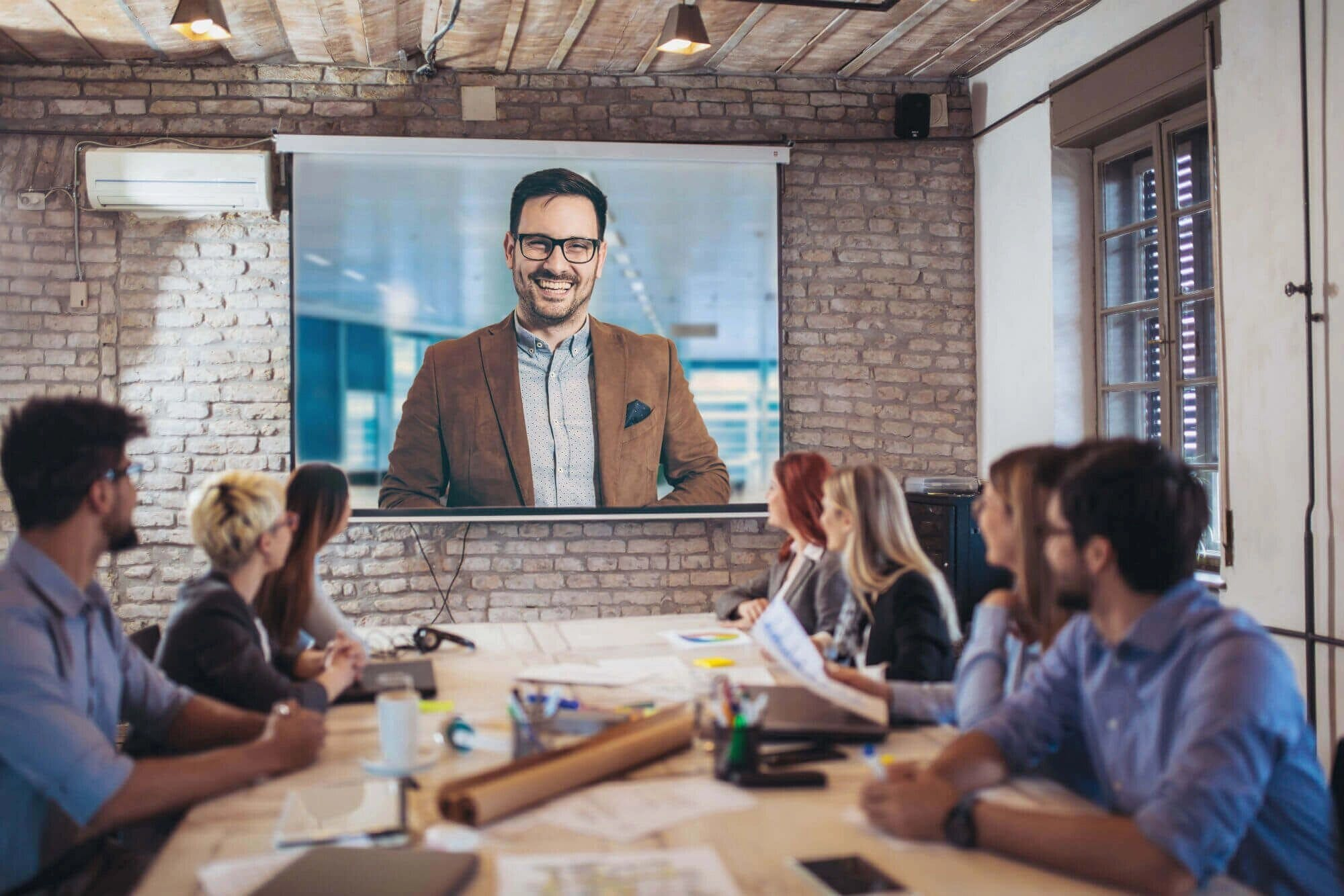 video conference of man with glasses