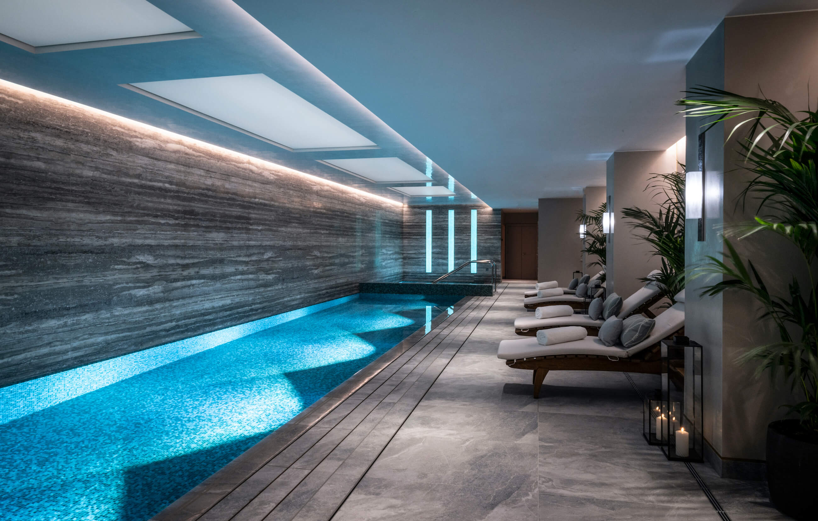 Indoor swimming pool with loungers