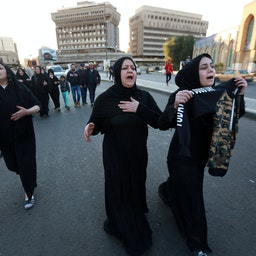 Relatives mourn for those killed in a twin suicide bombing attack in Baghdad, Iraq on Jan. 21, 2021. (Photo via Getty Images)