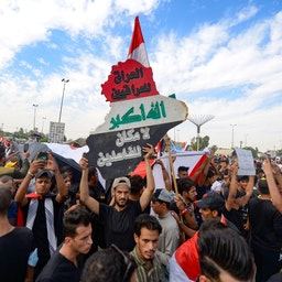 Iraqi protesters mark the first anniversary of the mass protest movement which saw demonstrators demand better public services, reform and an end to rampant corruption. Najaf, Iraq. Oct. 25, 2020(Photo via Getty Images)