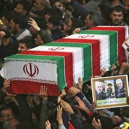 Mourners carry the coffin of slain Iranian military commander Qasem Soleimani, Karbala, Iraq, on Jan. 4, 2020. (Photo via Getty Images)