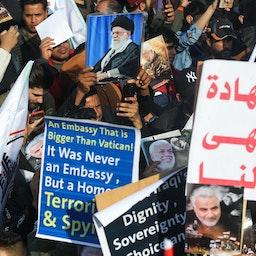 تجمع تظاهرکنندگان عراقی در سالگرد کشته شدن المهندس و سلیمانی در بغداد، ۱۴ دی ۱۳۹۹/ ۳ ژانویه ۲۰۲۱  (عکس از گتی ایمیجز)