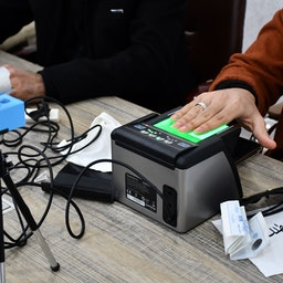 An Iraqi woman updates her voter registration at the Independent High Electoral Commission Center in the southern Iraqi city of Nasiriyah in the Dhi Qar province on January 12, 2021.(Photo by ASAAD NIAZI/AFP via Getty Images)