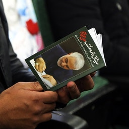 A man holding a book containing Soleimani's will on the first anniversary of his assassination, Sanandaj, Iran Jan 8, 2021. (Photo via Fars News Agency)