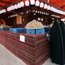 Women buy desert truffles in Kuwait City, Feb. 3, 2021. (Photo via Getty Images)