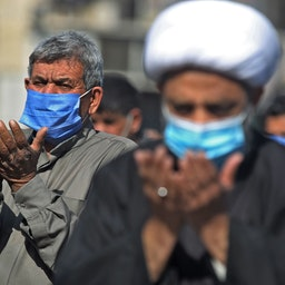 Iraqis perform Friday prayers in Sadr City, Baghdad on Jan. 29, 2021, amid the coronavirus pandemic. (Photo via Getty Images)