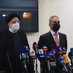 Chief Justice of Iran Ebrahim Raisi (L) and head of the Iraqi Supreme Judicial Council Faiq Zaidan (R) during a joint press conference in Baghdad, Iraq on Feb. 09, 2021. (Photo via Getty Images)
