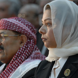 Raghad, the daughter of Iraq's late former president Saddam Hussein, sits next to Yemen's Baath Party leader Qassem Sallam on Feb. 7, 2007 (Photo via Getty Images)