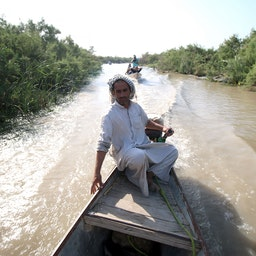 A man on a boat ride in the Iraqi Marshlands. July 14, 2016 Maysan governorate, Southern Iraq (Photo via Getty Images)