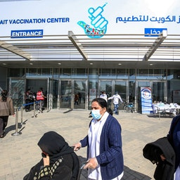People outside Kuwait's COVID-19 Vaccination Centre in Kuwait City on Feb. 1, 2021 (Photo via Getty Images)