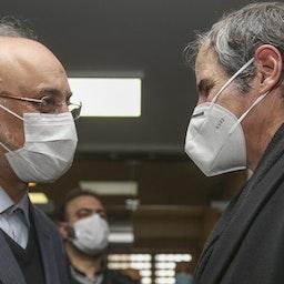 Iran's nuclear chief Ali Akbar Salehi and IAEA director Rafael Grossi in Tehran on Feb. 21, 2021. (Photo by Mohammad Babai via IRNA news agency)