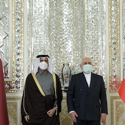 Qatar's Foreign Minister meets his Iranian counterpart in Tehran, Iran on Feb. 15, 2021 (Photo via Getty Images)
