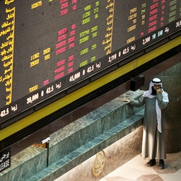 A Kuwaiti trader at the Kuwait Stock Exchange (KSE), Kuwait City on Jan. 2, 2017 (Photo via Getty Images)