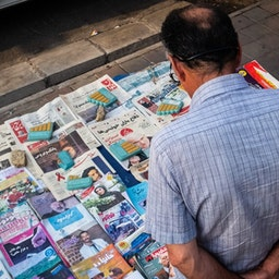 An Iranian man looking at newspapers and magazines at a Tehran newsstand, Aug. 6, 2020. (Photo by Seyyed Javad Mirhosseini via Mehr News Agency)