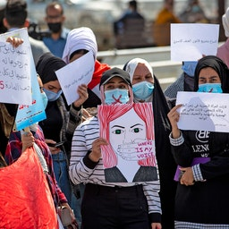 Demonstrators wearing crossed-out masks attend a rally for International Women's Day in Iraq's southern city of Basra on March 8, 2021. (Photo via Getty Images)