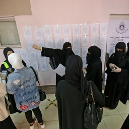 Women arrive to cast their votes at a polling station in Kuwait City, on Dec. 5, 2020 (Photo via Getty Images)